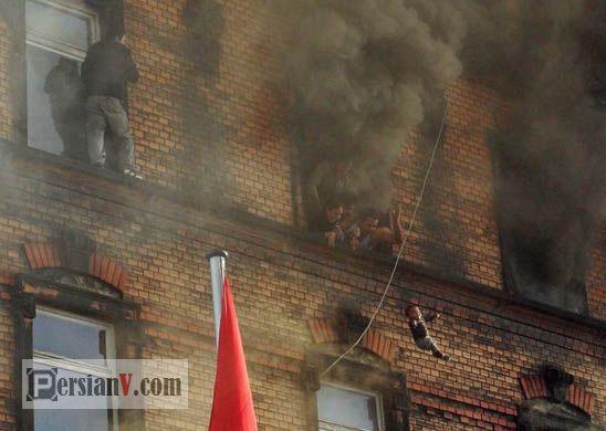 عکس : لحظه پرتاب نوزادی از ساختمان