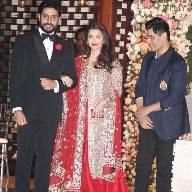 تیپ آیشواریا رای در کنار همسرش با یک لباس فاخر هندی+عکس