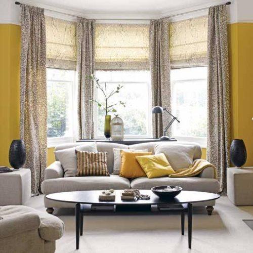 اتاق نشیمنی با تم زیبای زرد و طوسی