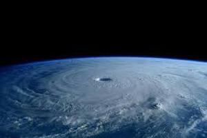 گردبادی به بزرگی زمین روی خورشید