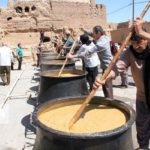 تصاویری از پخت آش گندم نذری یزد به مناسبت عید فطر