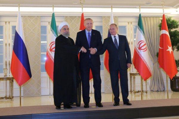 دست دادن روحانی و اردوغان