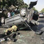 واژگون شدن خودروی پژو ۲۰۶ پس از تصادف با دنا در تهران!