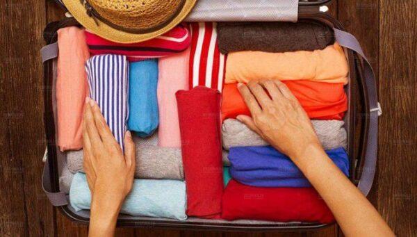 طریقه چیدن لباس در چمدان
