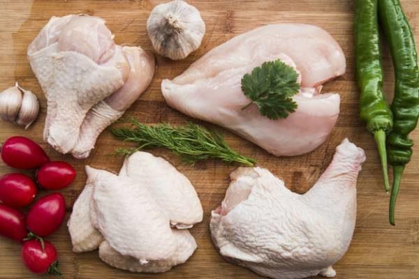 عوارض مرغ نیم پز